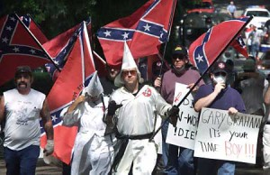 Ku Klux Klan wave the flag of their heritage