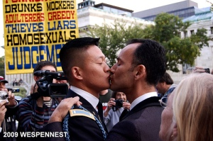 Sharing a kiss in front of bigoted homophobes