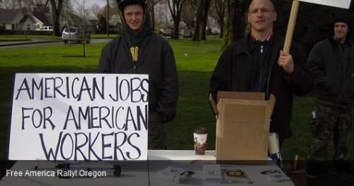Kyle Brewster (right) sneering at Free America Rally on February 23, 2013