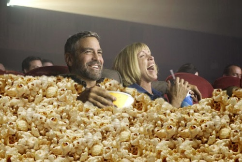 George-Clooney-Eating-Popcorn-at-Movies-64616